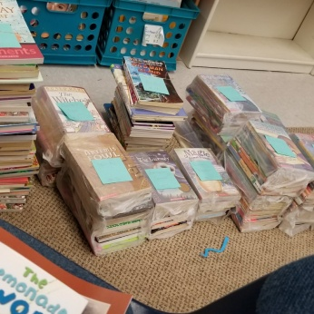 Getting books organized for the new library!